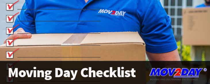 Mover carrying a box - Moving Day Checklist blog from Mov2Day Naples, FL